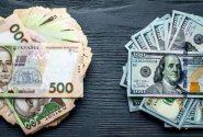 Грівневі та доларові банкноти
